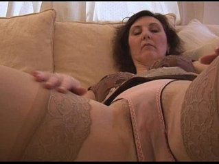 Busty mature attractive English lady strips