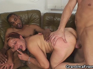 Granny swallows two cocks at once