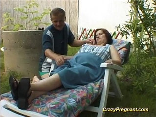 pregnant lady has her naked body massaged
